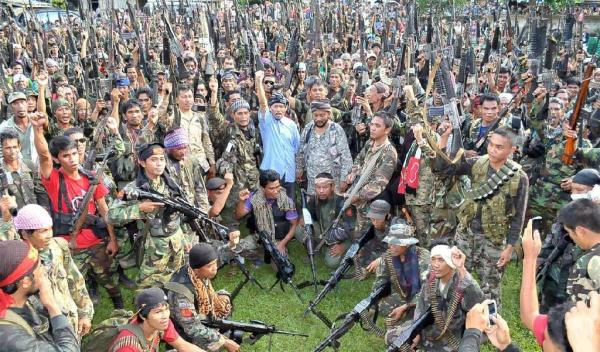 Note: Nur Misuari is the elderly gentleman in a  blue shirt with his raised fist clenched in the air.
