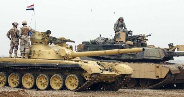 Iraqi T-72 MBT beside an M1A2