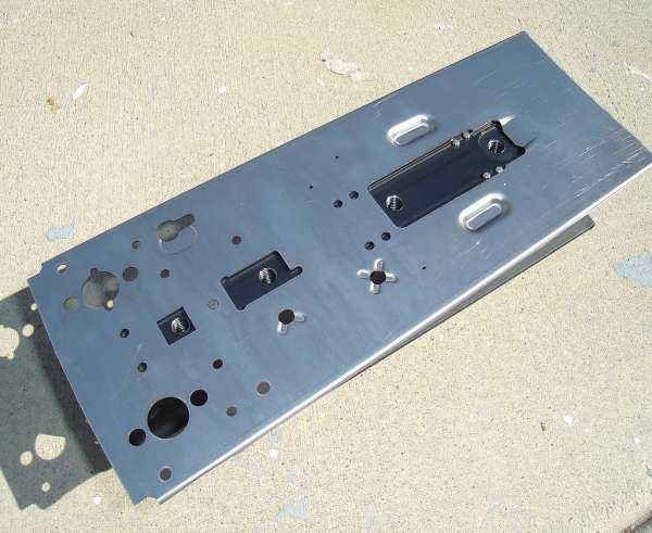 Stamped Receiver plate. Note how the front end is narrower than the back, where larger hales have been drilled to support an underfolding metal stock. The edges have also been curved to better fit the Dust Cover.