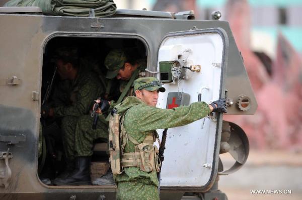 Tajikistan Army soldiers APC