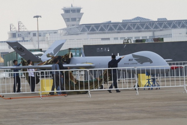 Chinese Wing Loong MALE UAV with people